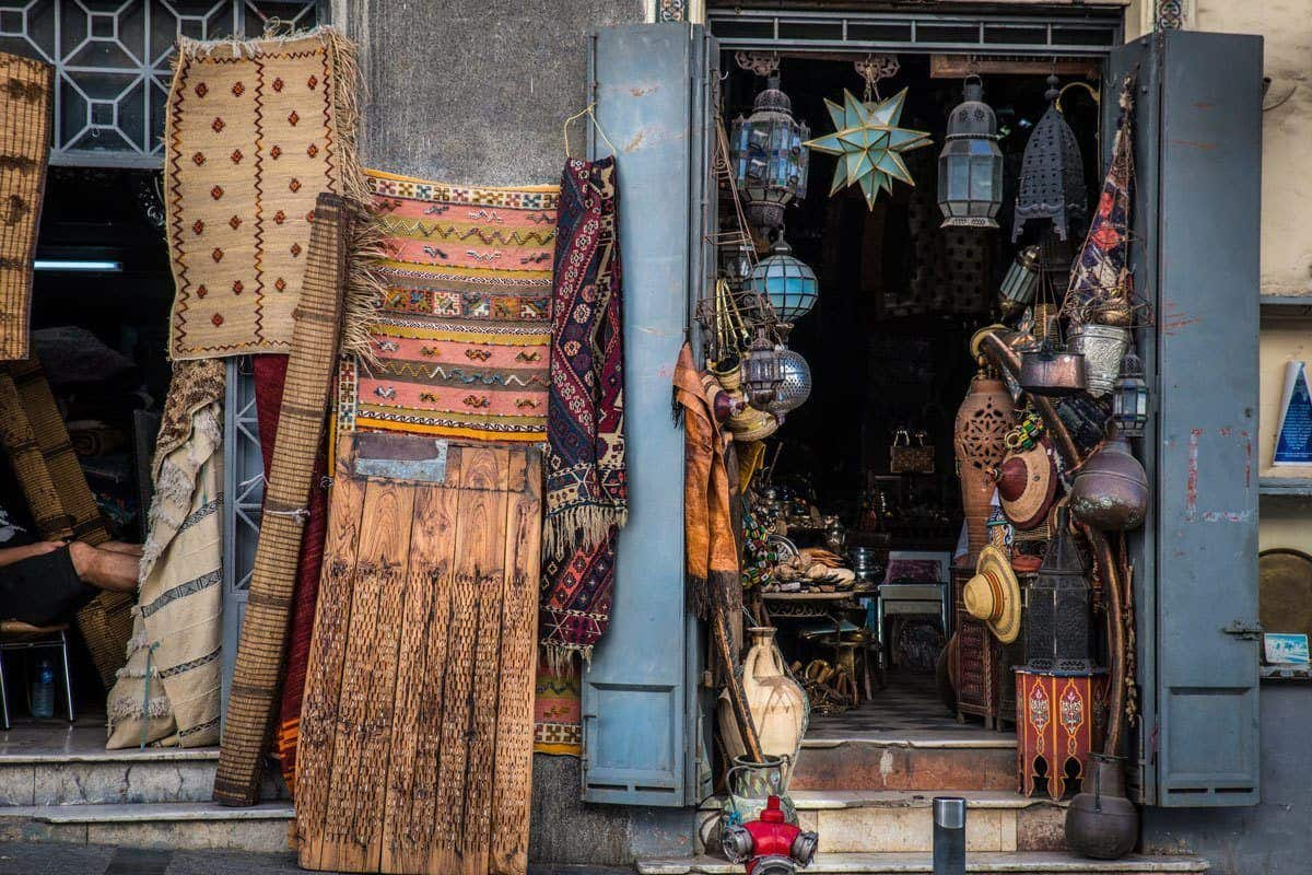 Carpets, pots and lanterns in street stall Tangier. This is one of the best Day trips from Seville. Go on the best day trips Seville to Tangier