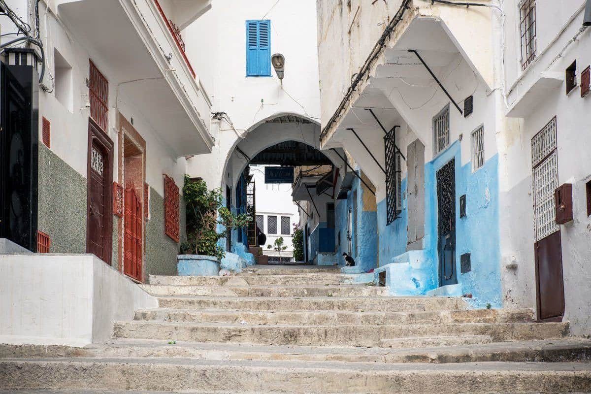Steps out of medina with white walled houses in Tangier. You probably never thought of adding a Day trip from Seville to Tangier in your Seville itinerary.