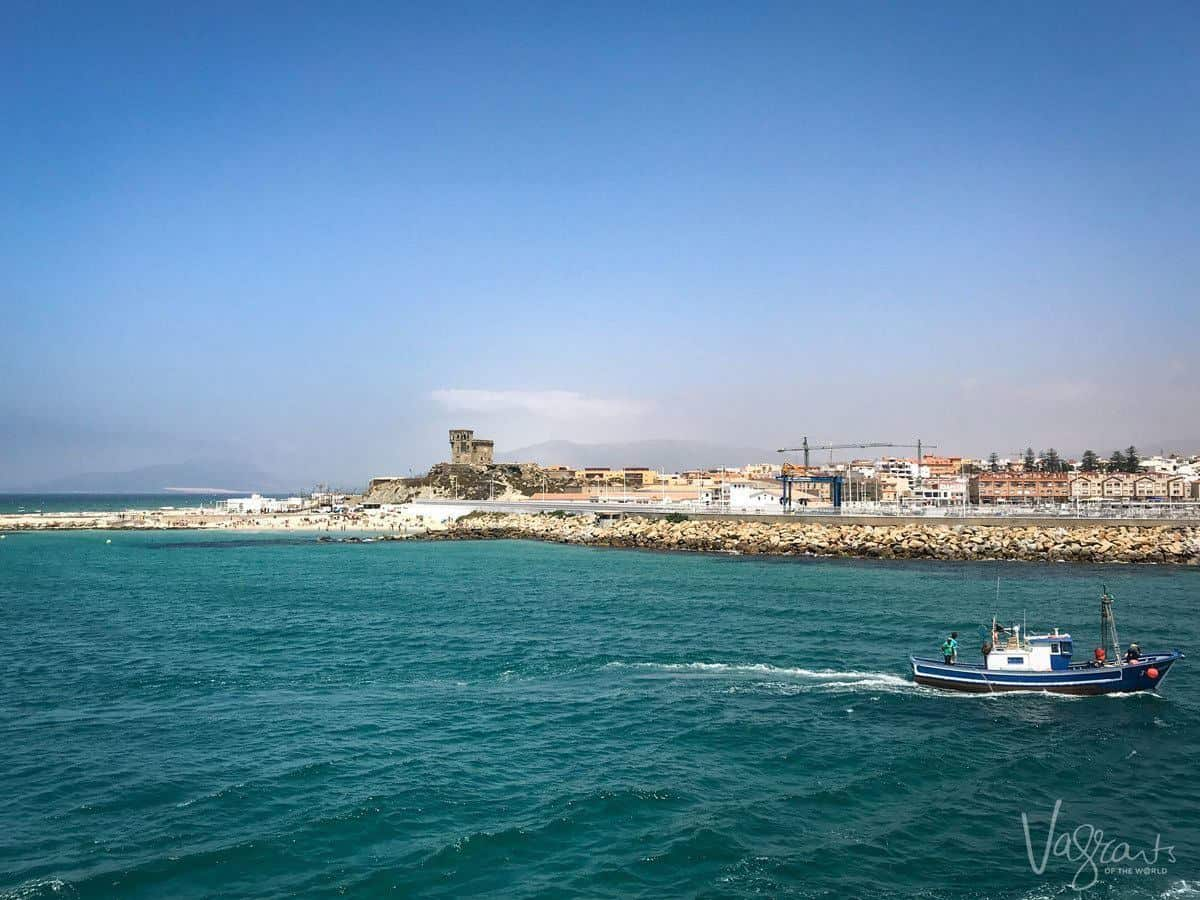 fishing boat coming into port in Tarifa. Looking for the Best Day trips from Seville. Try a day trip from Seville to Tarifa
