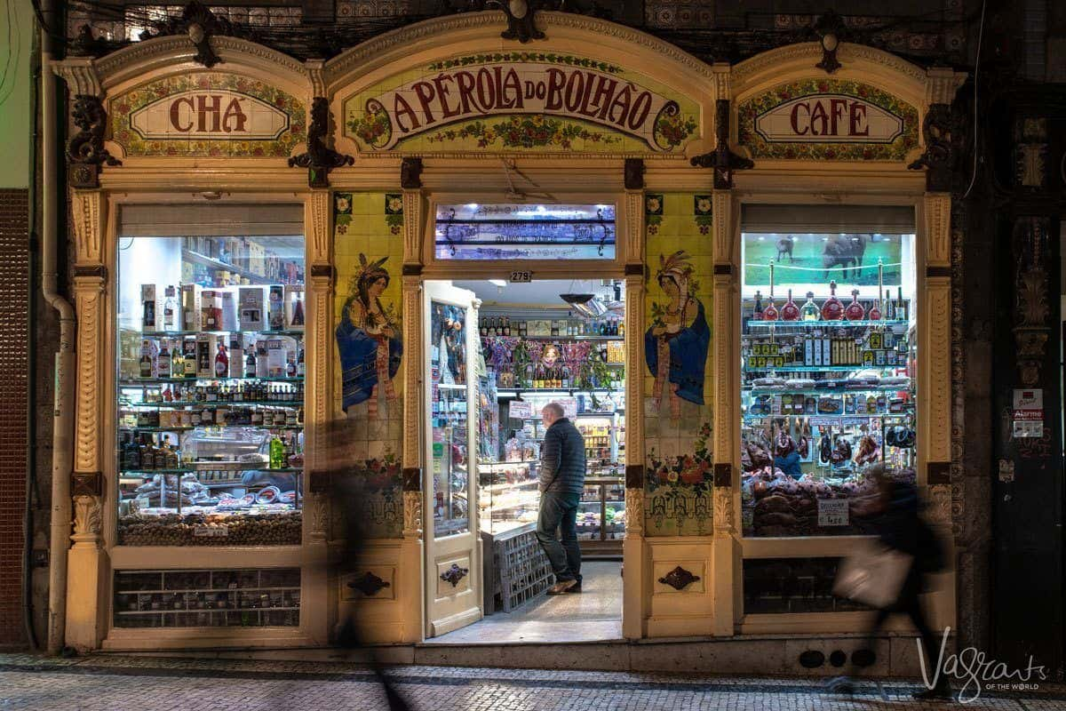 Old worldly A Perola do Bolhao Deli Porto with its three arches and windows full of deli items just waiting to be taken home and turned into the best ever Portuguese meal.