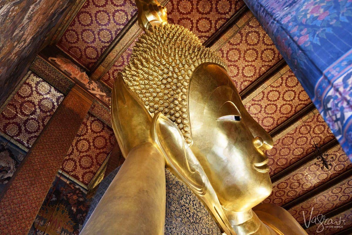 looking up at golden buddha head. angles are one of the best Travel Photography Tips for Getting the Best Landmark Shots