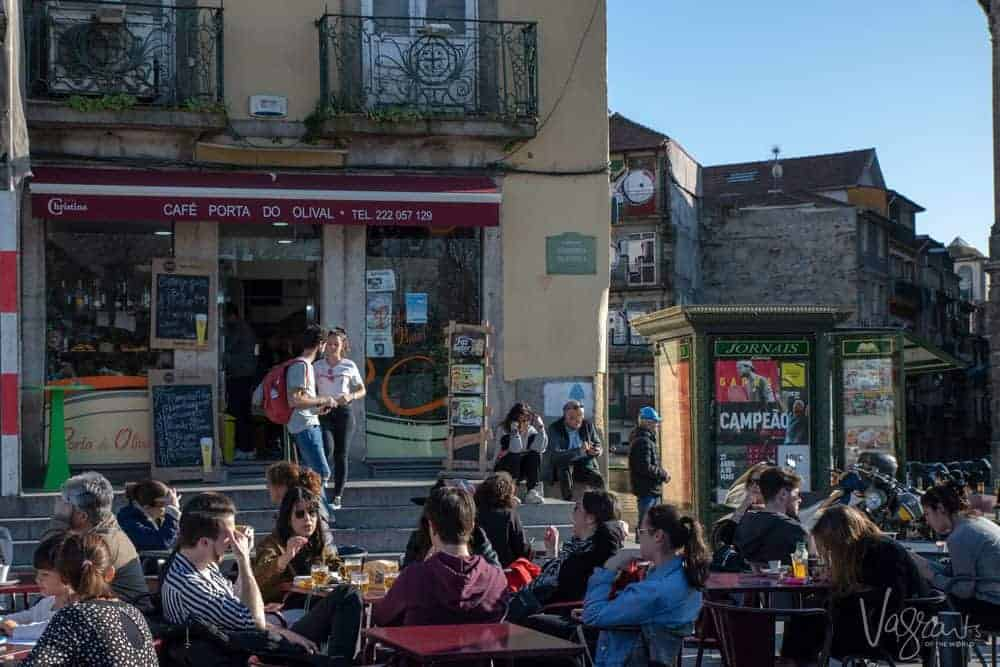 Porto's oldest cafe's - Cafe Portas do Olival with a large crowd enjoying coffee out the front.