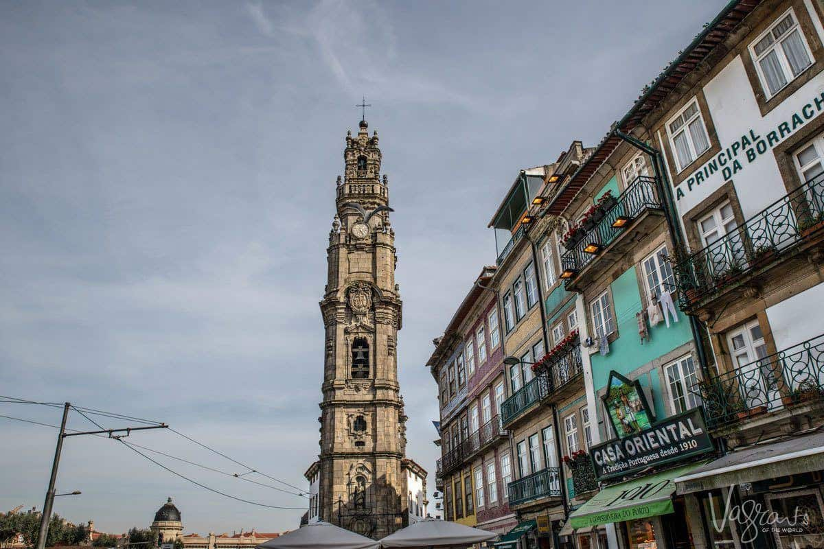 Clock tower of Torre dos Clerigos Church with swirling cloud skyline in the centre of Porto where all the best places to visit in Porto are.