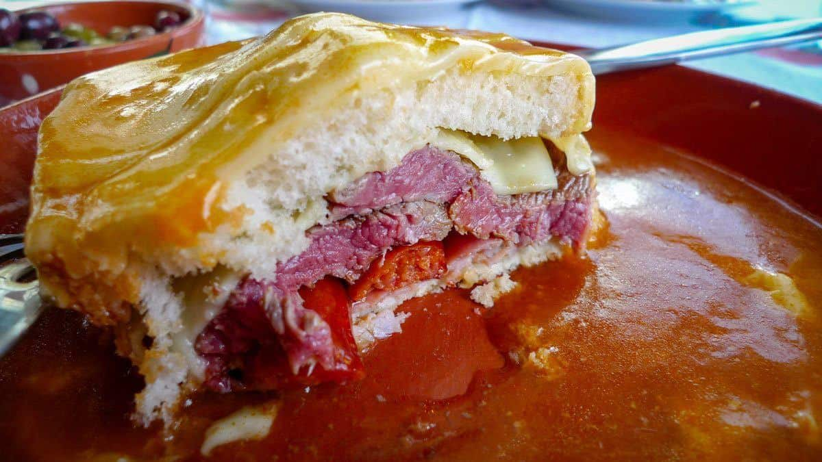 You must try a francesinha sandwich, this cheese covered meat sandwich is floating in tomato beer sauce and is disgusting.