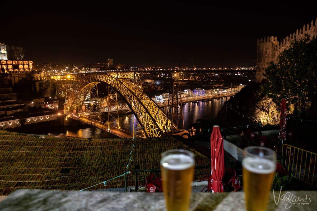 Beers with a view of the lit bridge at night from the beer garden at Guindalense Football Club.