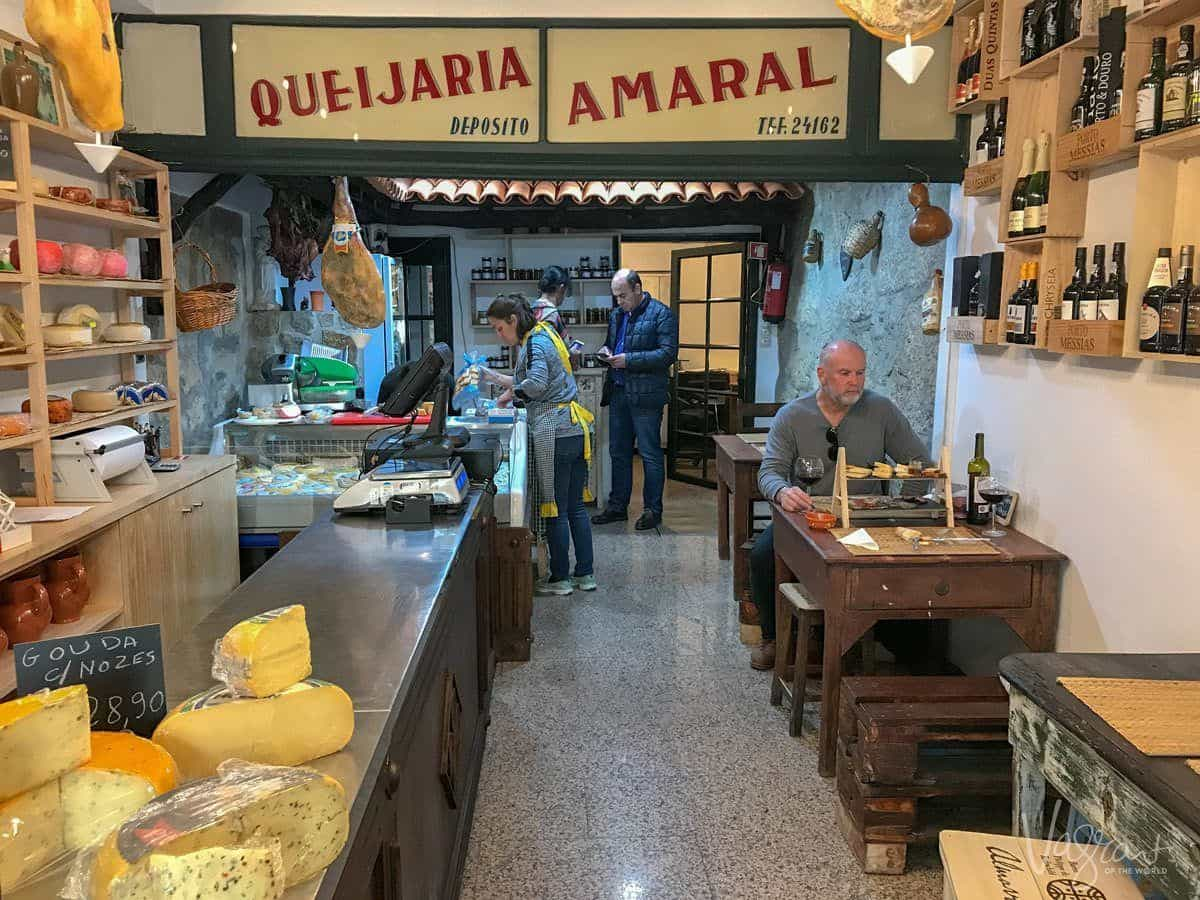 This is me trying to eat my own weight in cheese at Queijaria Amaral Porto's oldest cheese shop and my favourite place to eat in Porto.