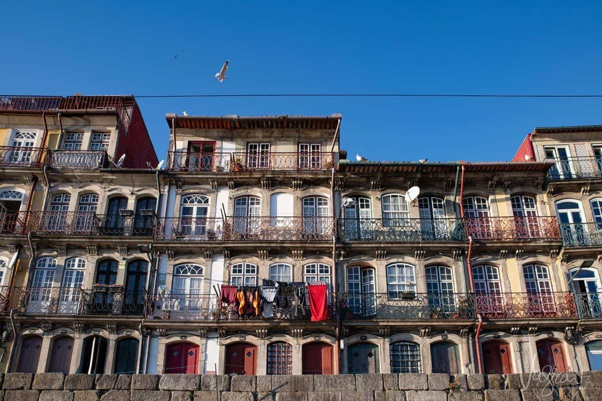 Washing hanging on the balconies in Ribeira neighborhood, living like a local in Porto.