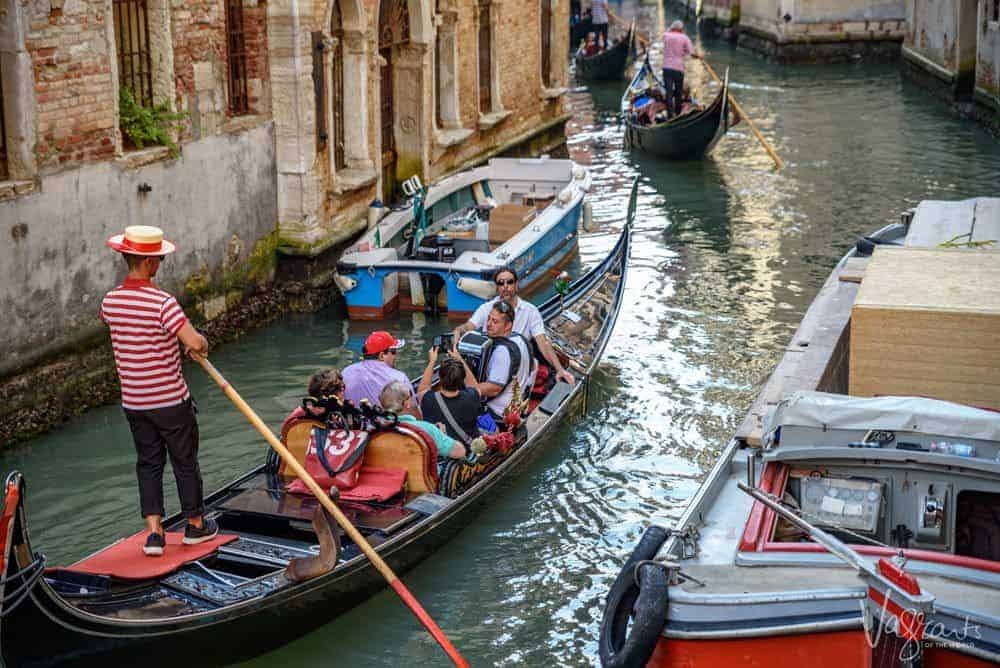 Travel safety - Tourists on a gondola ride in Venice