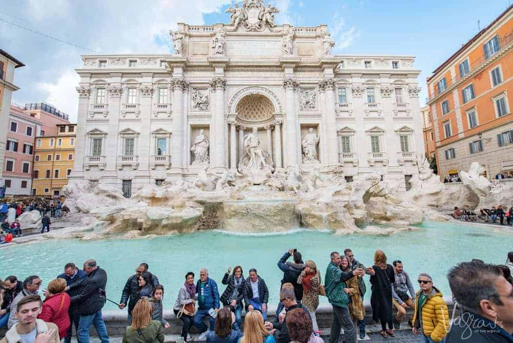 Guide to safe travel - Tourists crowded in front of the Trevi Fountain in Rome