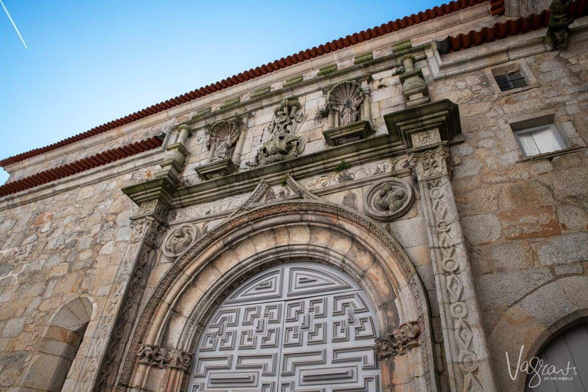Ornate doors and archway of sandstone coloured Church of Santa Clara, a great place to visit in Porto if you are looking for free things to do.