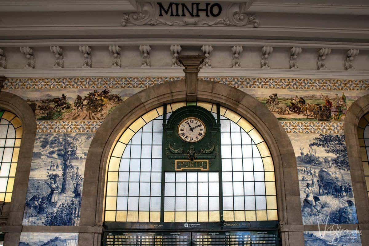 Clock and window inside Sao Bento Train Station. This main porto attraction is also one of the best free things to do in Porto.