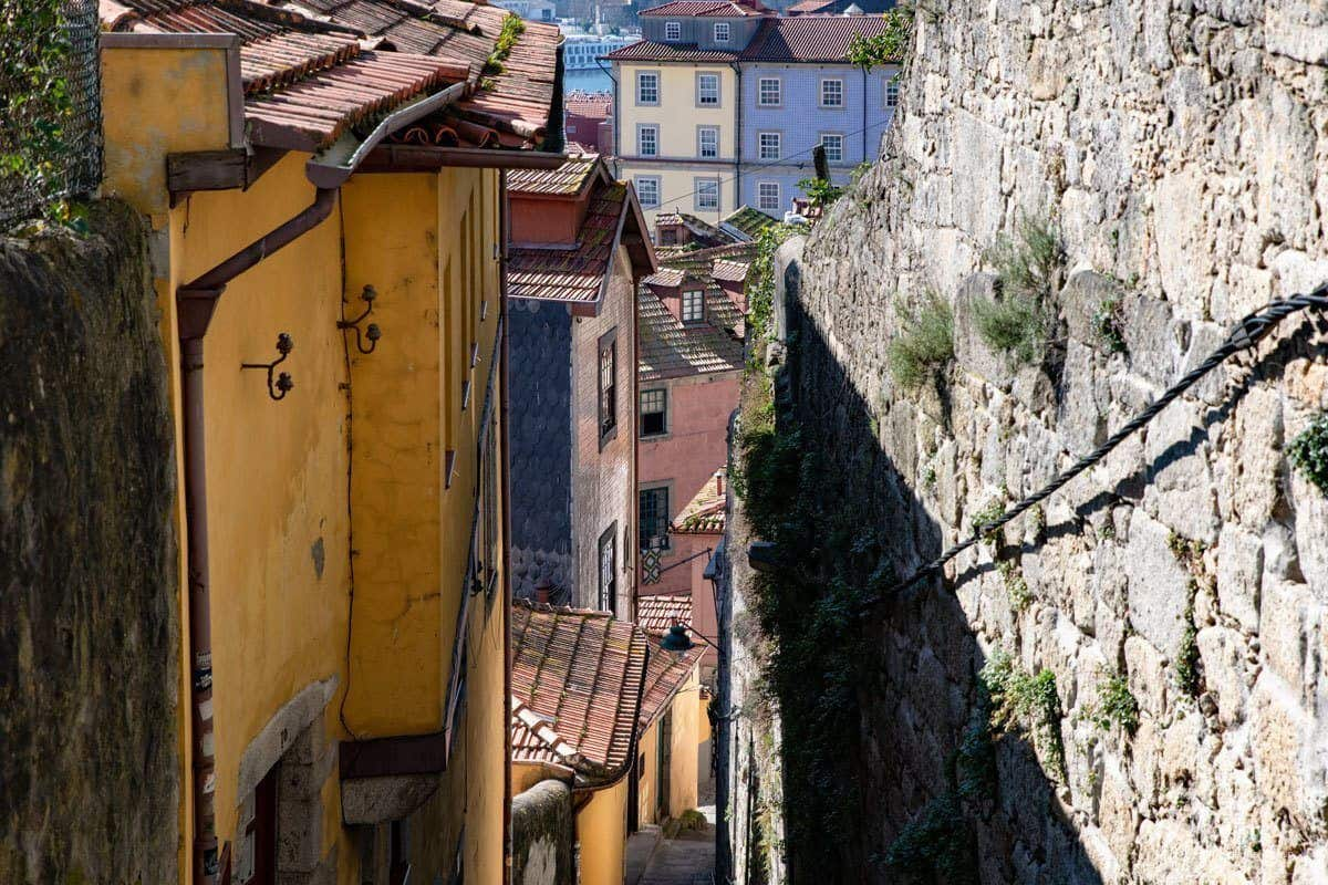 The steep stairs flanked by stone walls and ancient yellow houses leading up from the river Douro.