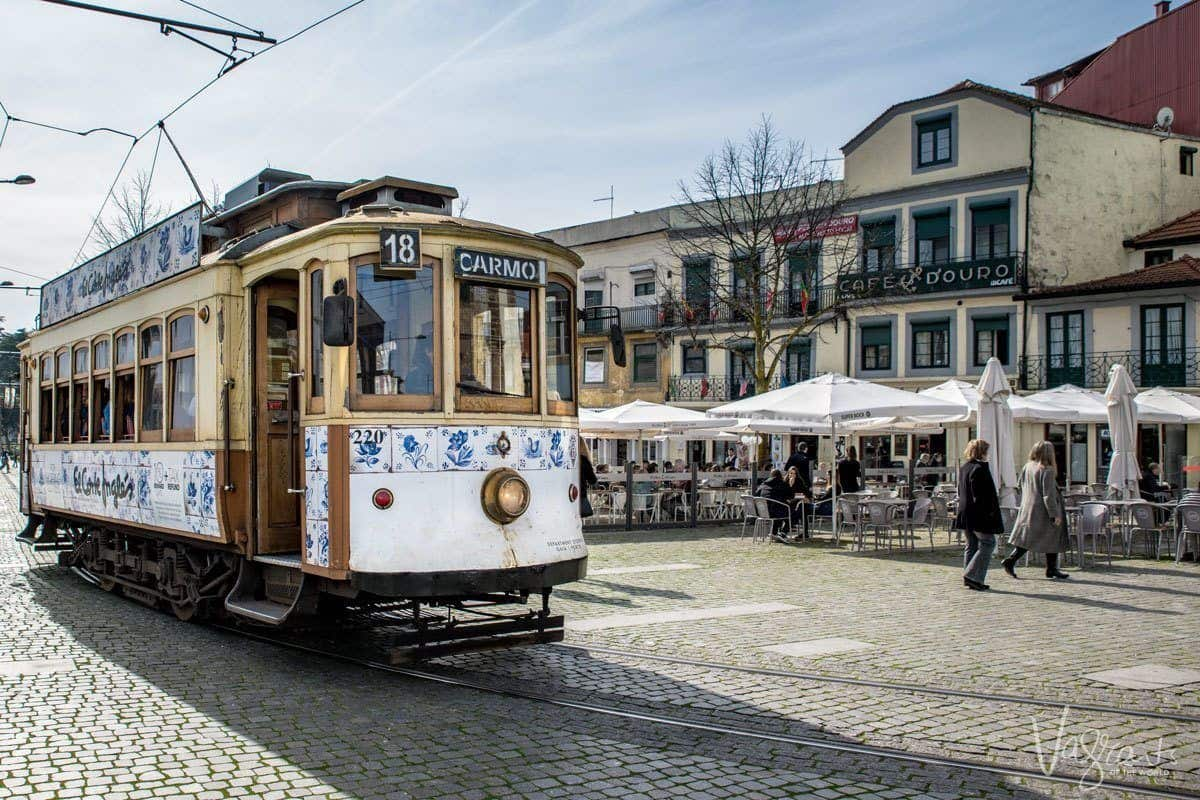 Ride this historic tram 18 Carmo from in front of outdoor cafe.
