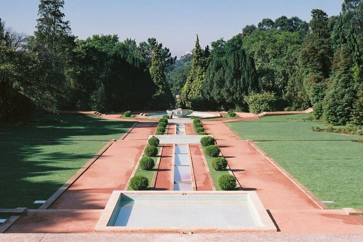 Red rocks and green grass and trees with leading lines at Casa de Serralves.