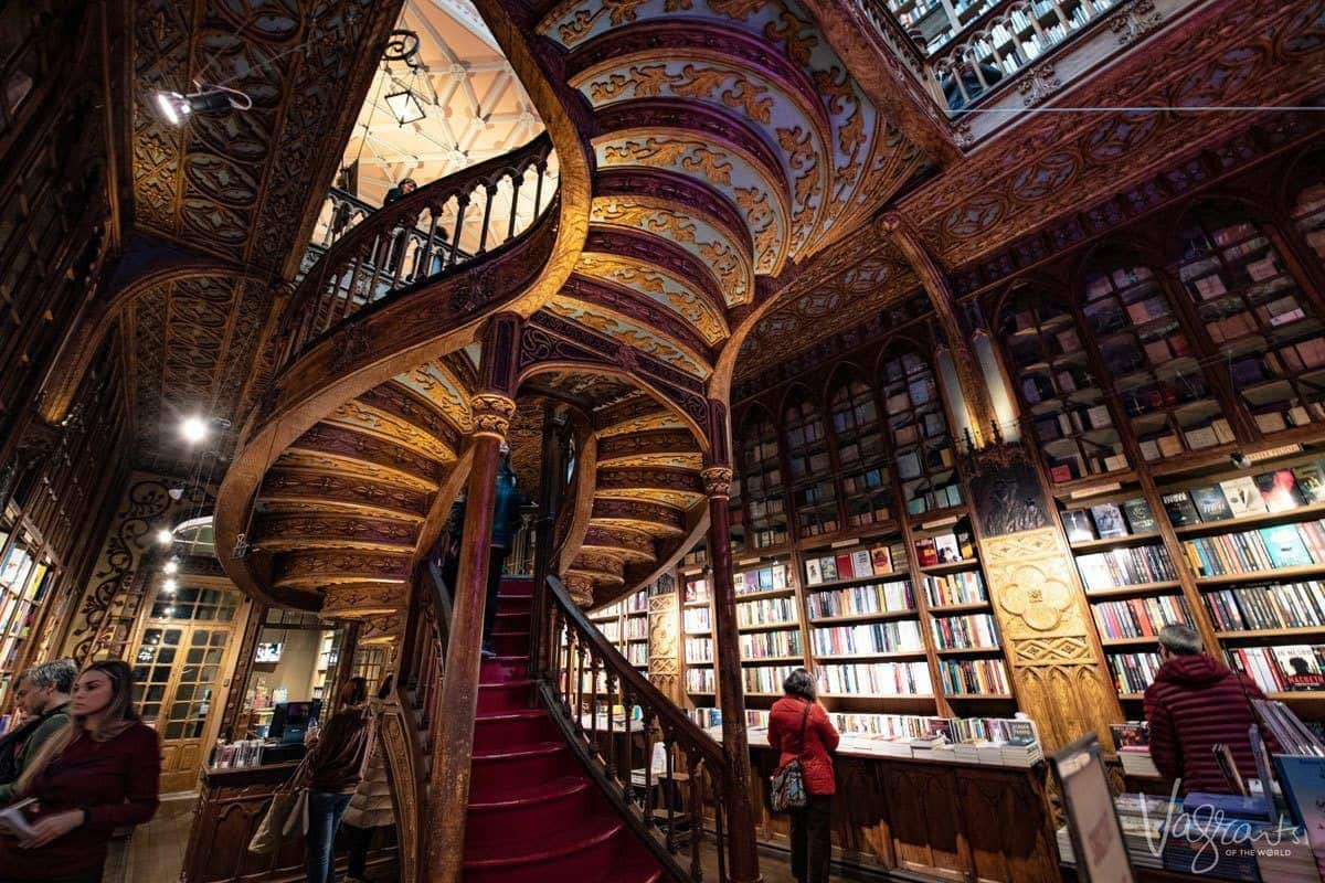 Gold wooden carvings under the spiral staircase at the Livraria Lello Bookshop.