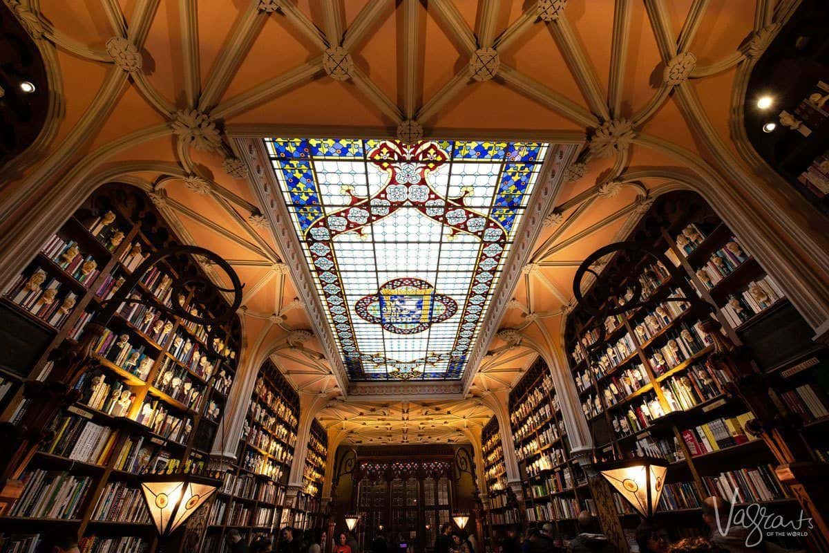 Patterned stained glass ceiling at Livraria Lello Bookshop a must see porto attractions