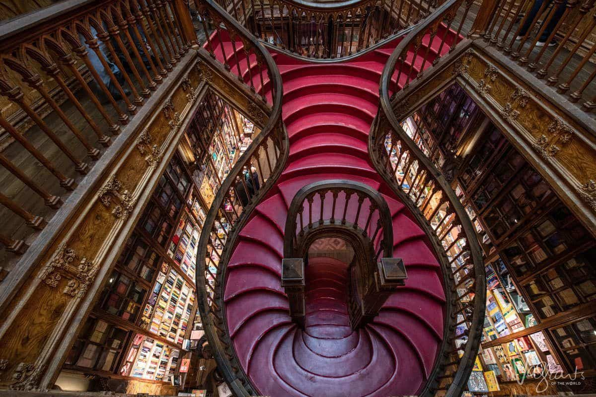 When you visit Livraria Lello Bookshop you will hope to see this downward view of the wooden spiral staircase sans the tourists, an unusual thing to see in Porto.