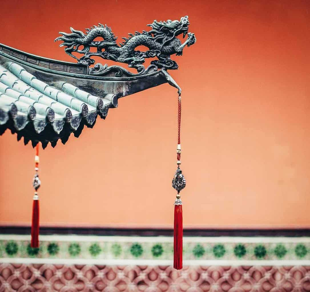 Dragon on pagoda with red tassles.