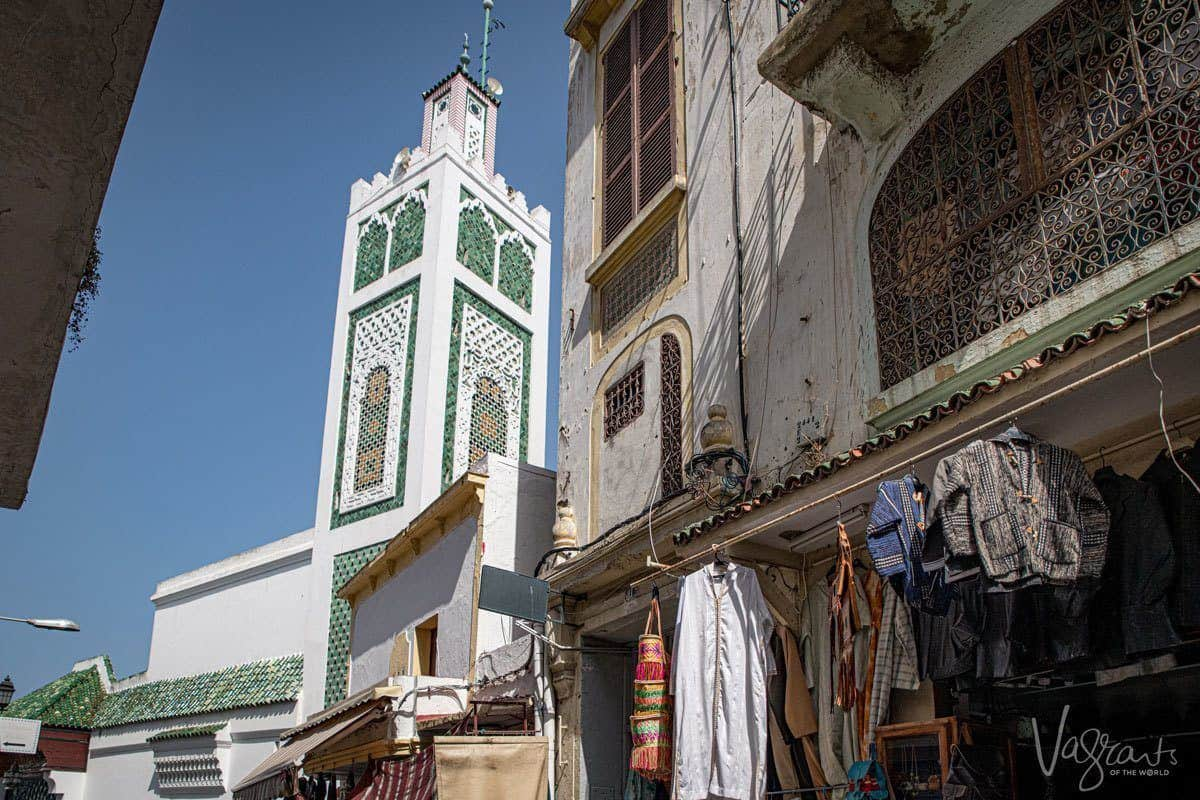 Green and white mosque at the end of a medina, Morocco