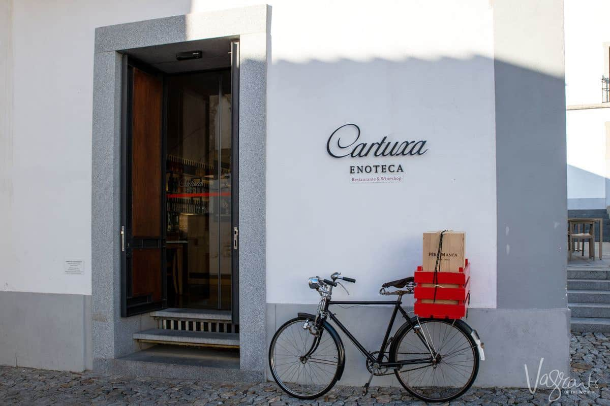 A bicycle parked outside a wine shop in Evora Portugal.