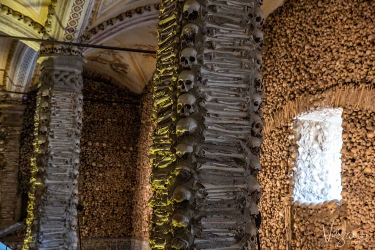Walls and pillars made of human bones in the church of bones. Stop here on your alentejo road trip as this rates as one of the best things to do in the alentejo portugal