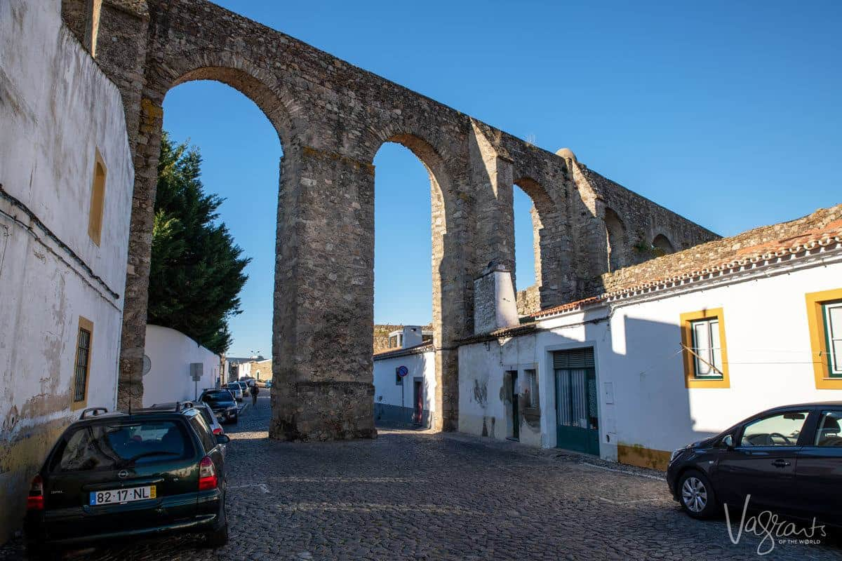 aqueduct running through and cutting off part of a cobble stone street. there are some really unique and obscure things to see in the alentejo