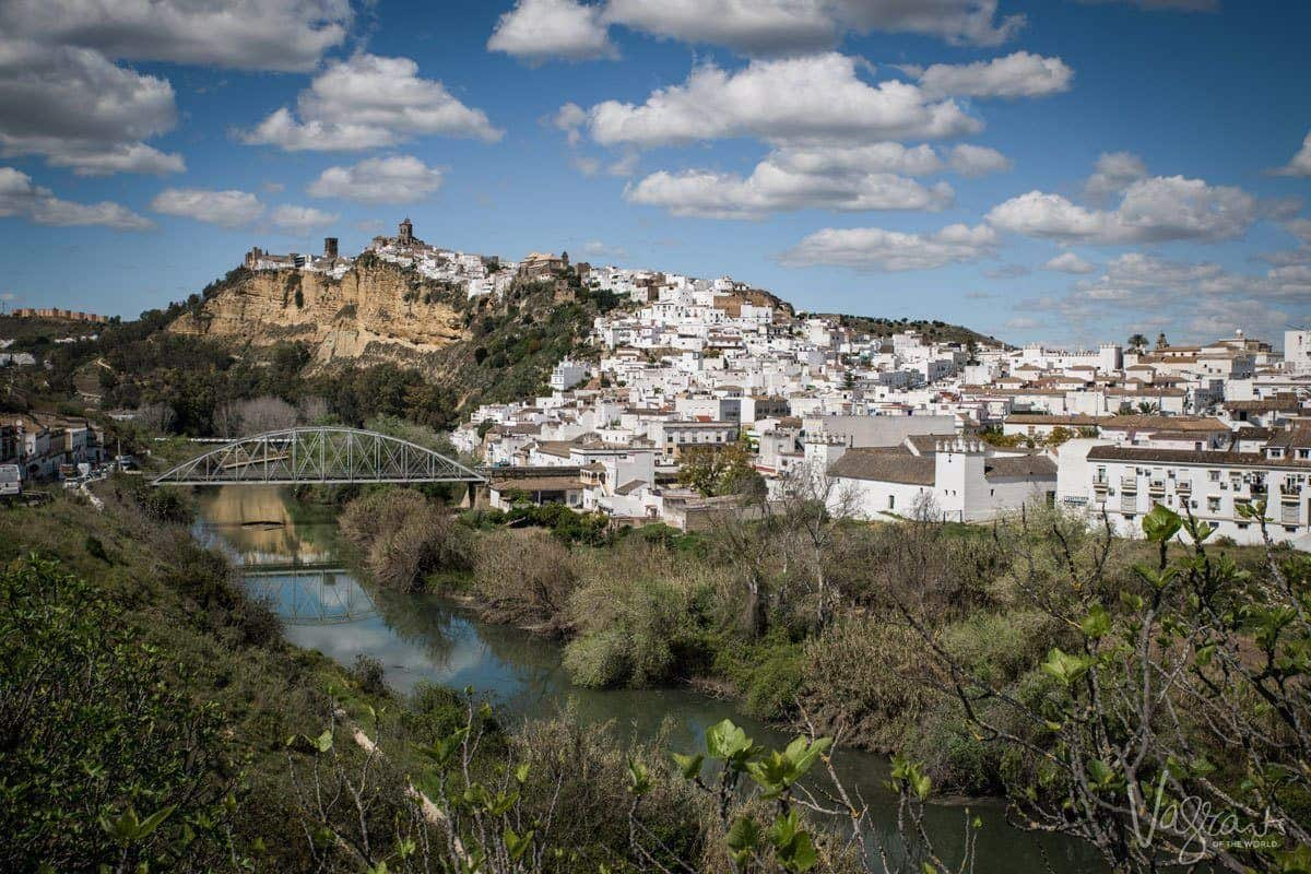 One of the most beautiful white villages of Spain, Arcos de la Frontera, white houses cascade down from the castle and cathedral along the riverfront.