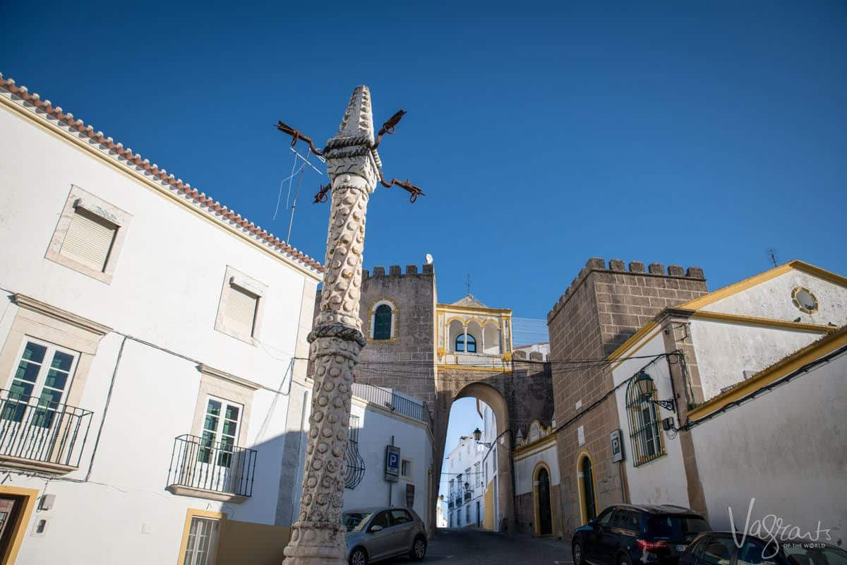 white pole in the square where they used to treat criminals quite badly by tying them up and beating them. a unique and obscure thing to see in the alentejo portugal