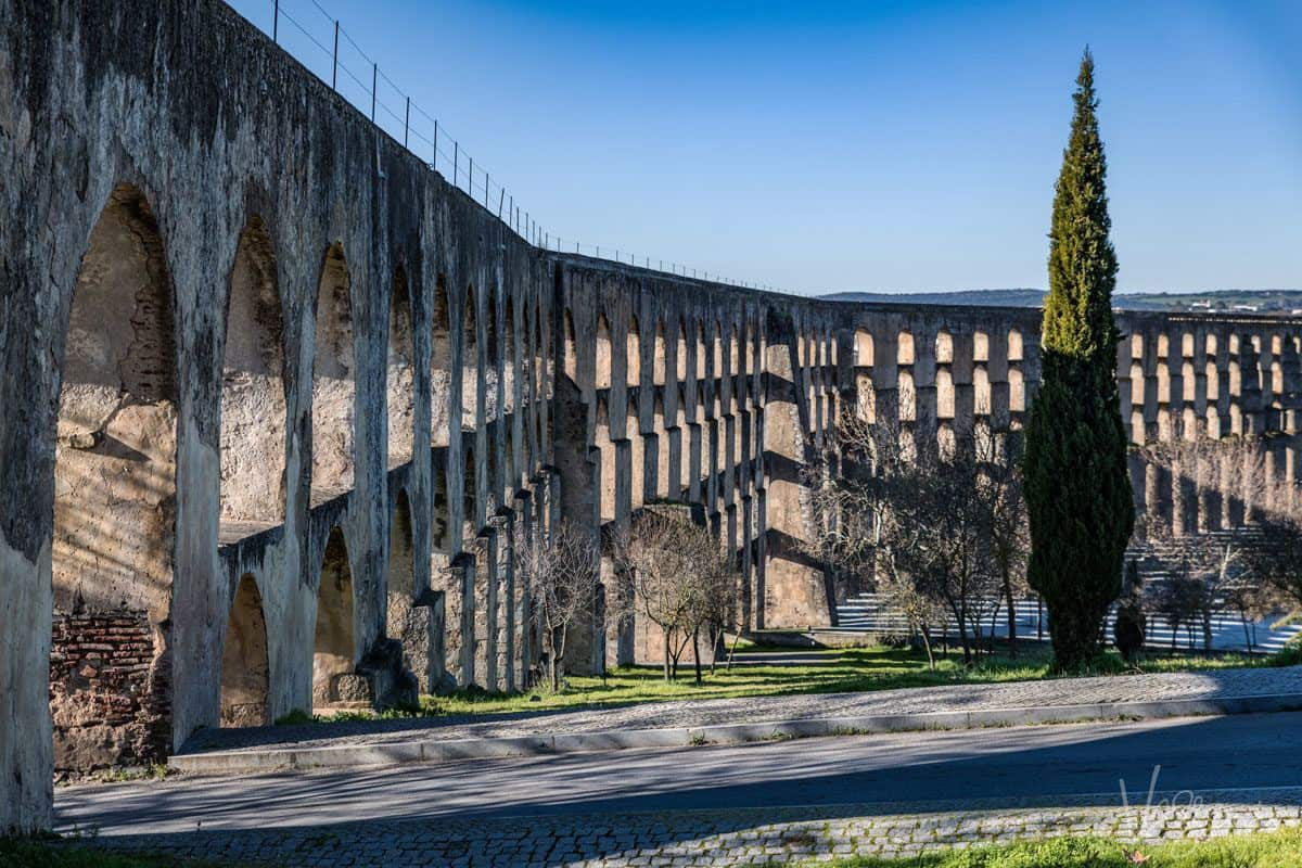 the very high aqueduct spanning across the city of elvas one of alentejo highlights and a must do on your alentejo portugal holiday