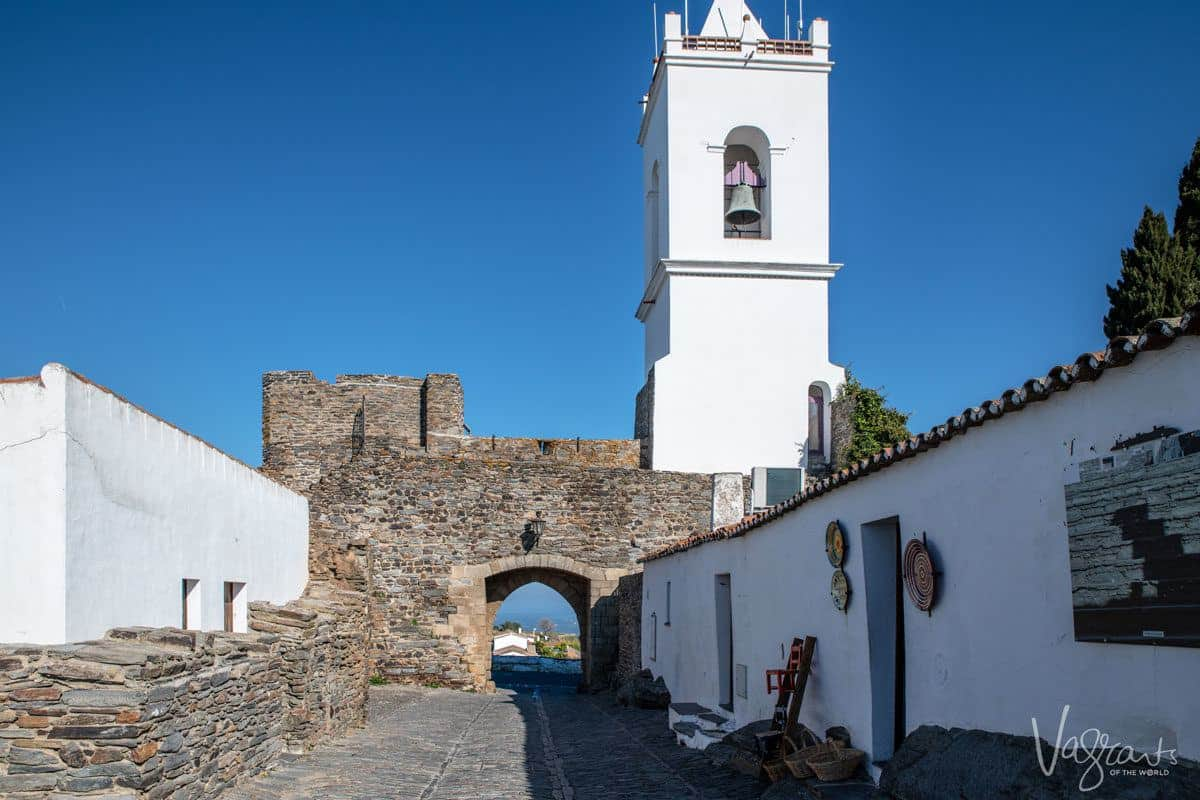 church tower and bell on top of castle wall in Monsaraz.  you can encorporate a visit to Monsaraz in day trips from evora or even lisbon.