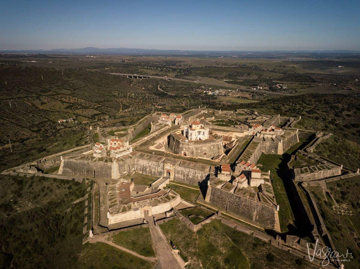 Arial view of star shaped forts, Santa Luzia and Nossa Senhora da Graça Fort. A unique experience on your alentejo road trip.