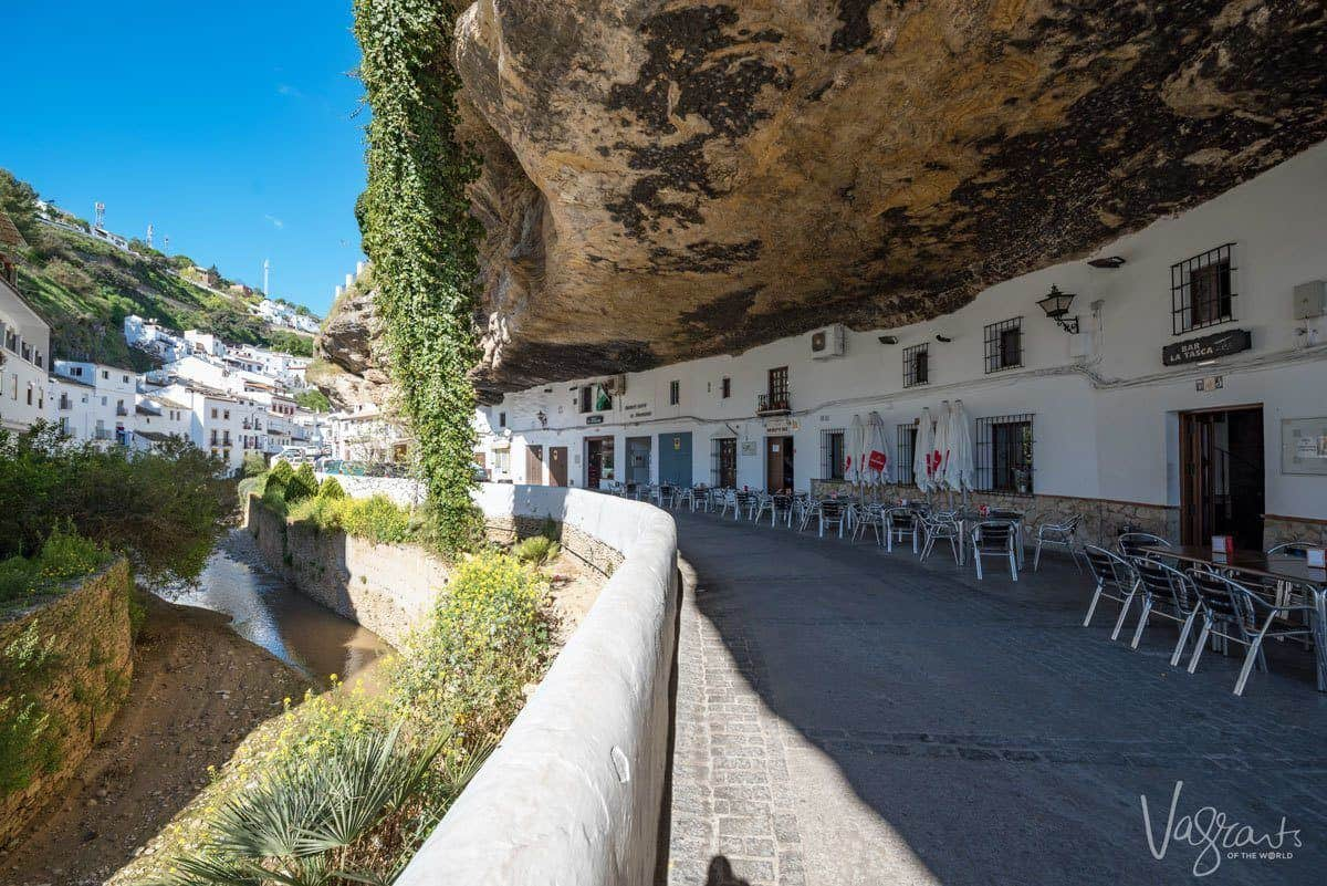 white houses and shop under overhanging rock in Setenil de las Bodegas.