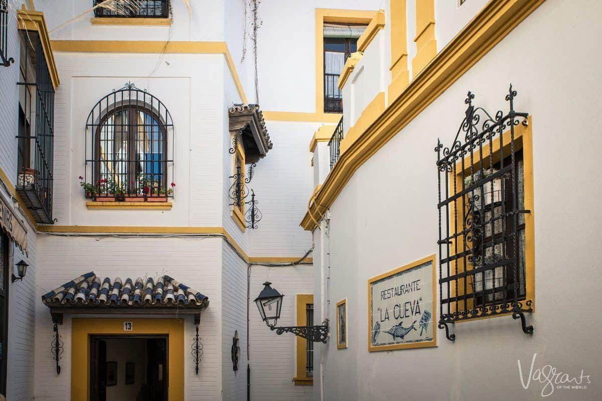 The beautiful white buildings of Seville's Barrio Santa Cruz. A great starting point for a Southern Spain itinerary