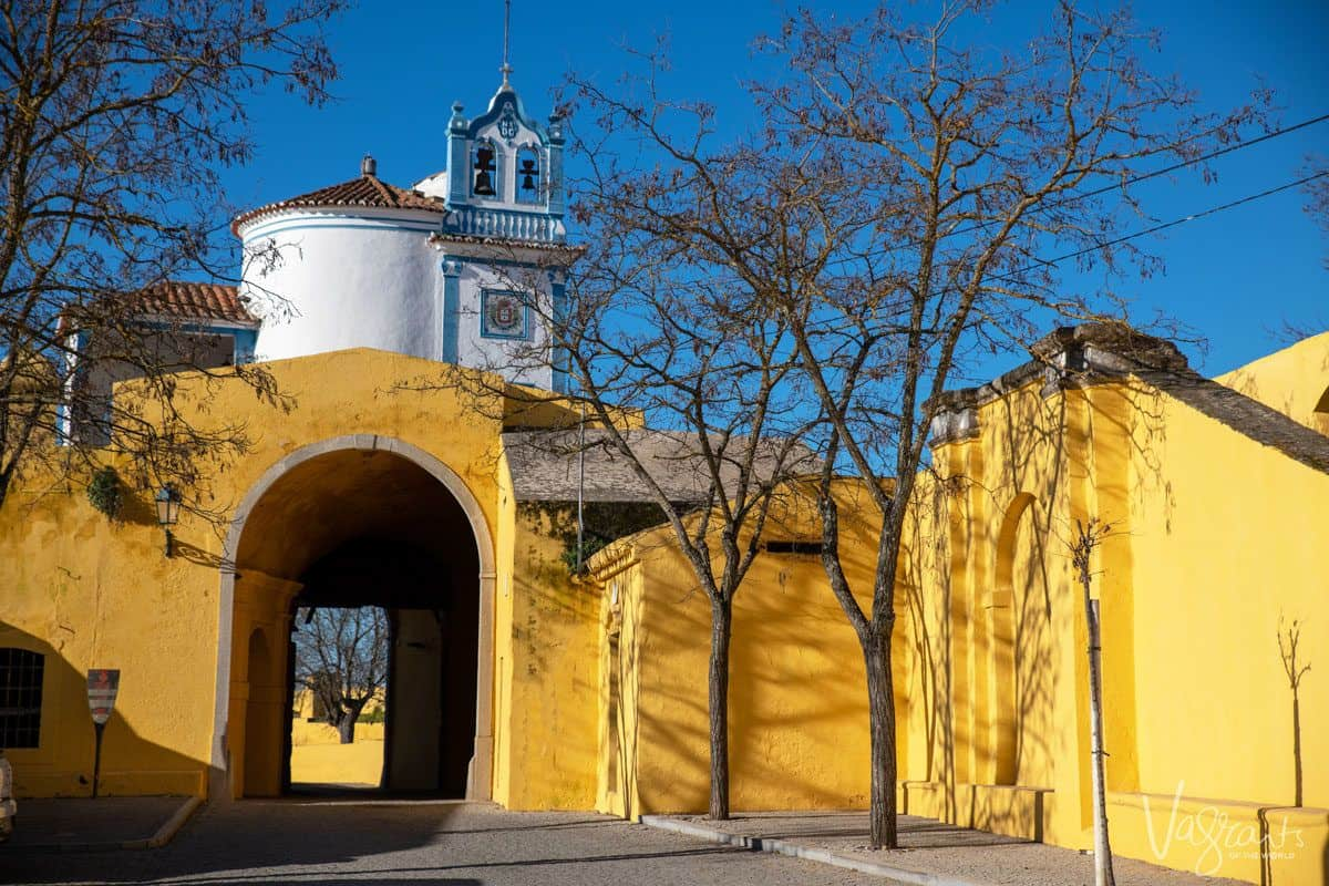 yellow walls and passage into ancient church. These old buildings are alentejo highlights along with alentejo food and alentejo wine. Alentejo portugal is also home to black pork a gastronomic highlight of any alentejo holiday