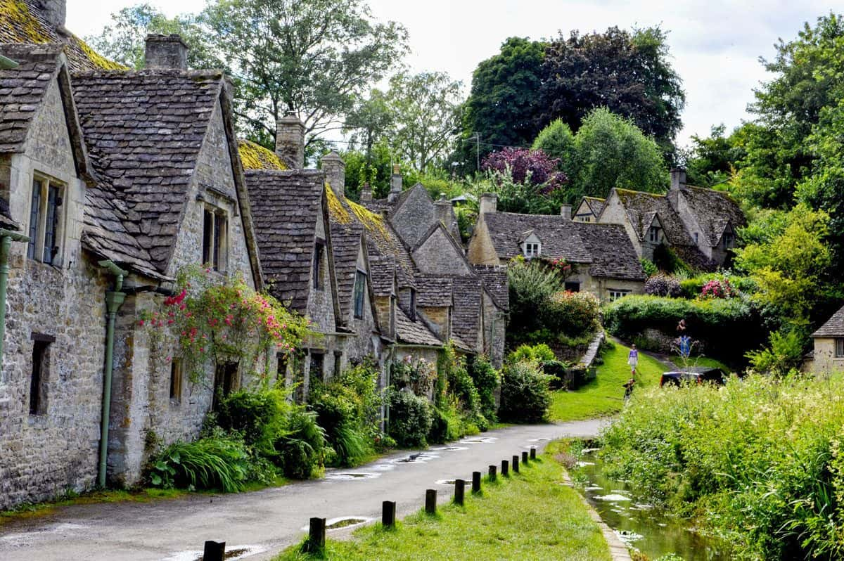 a row of stone houses with old tiled roofs in a country village.  Wales is a great location for on foot holidays UK
