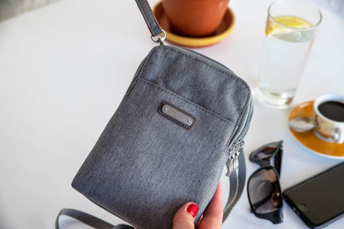 close up of a grey travel purse and this stylish design make it a perfect womens travel purse
