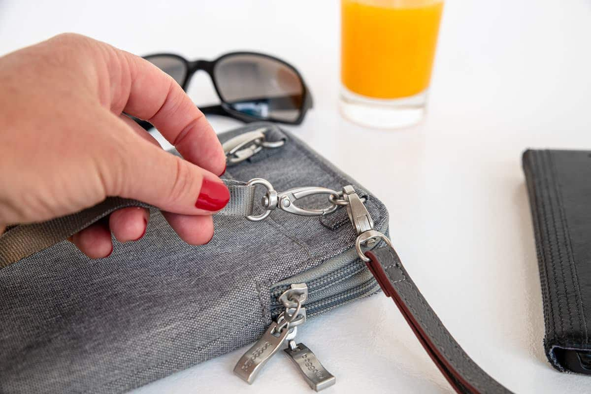 the lockable zippers on a womens travel purse giving it antitheft properties as well as stylish appeal