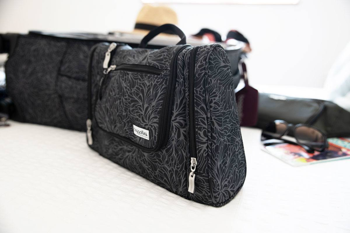 a grey travel toiletry bag perfect for popping into your baggallini carryon bag for women