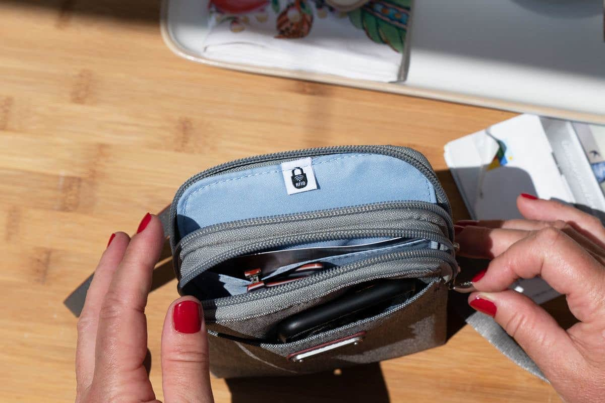 open travel purse showing rfid pockets. this is a popular theft proof bag