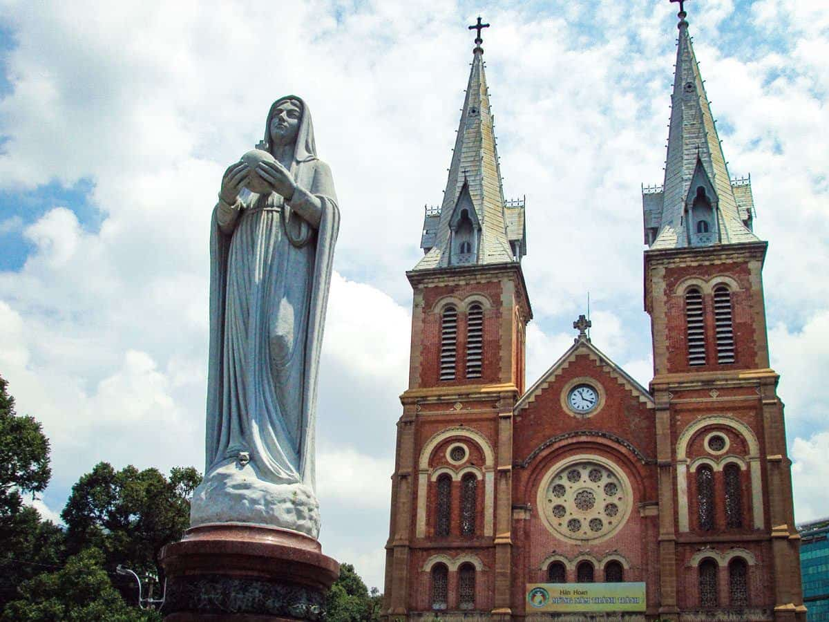 A statue of Our Lady outside the romanesque styled cathedral. On of the best places to visit in Ho Chi Minh city
