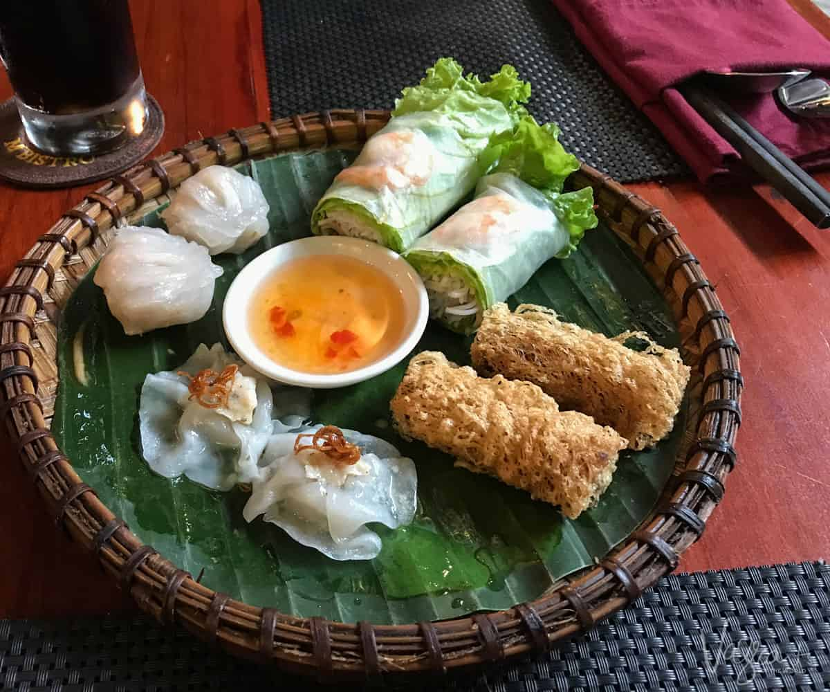 Vietnamese spring rolls and sauce which you can learn to make yourself with a Vietnamese cooking course in Hanoi Vietnam.