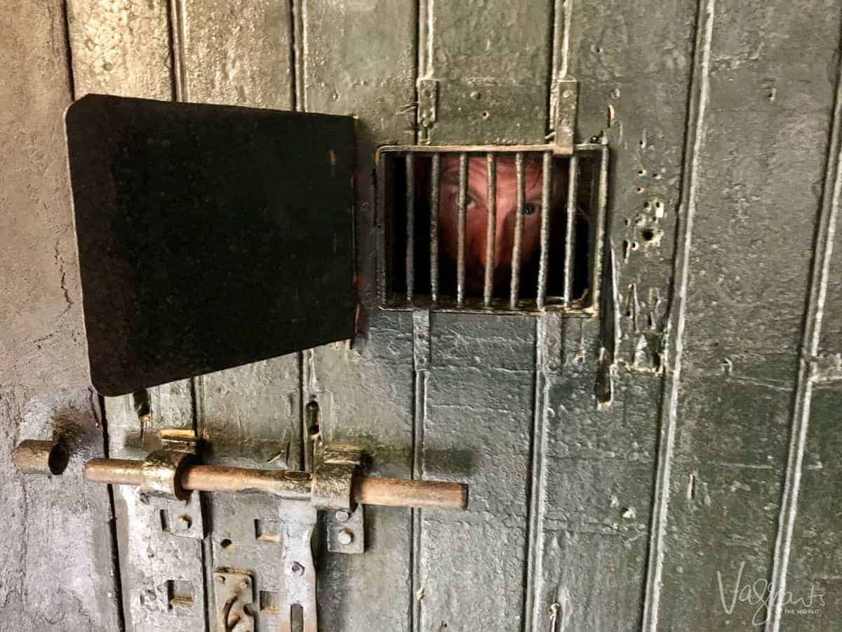 Another top thing to do in Hanoi Vietnam is to visit the Hoa Lo Prison Museum, here you see Uncle Mick behind the bars of this old prison cell door.