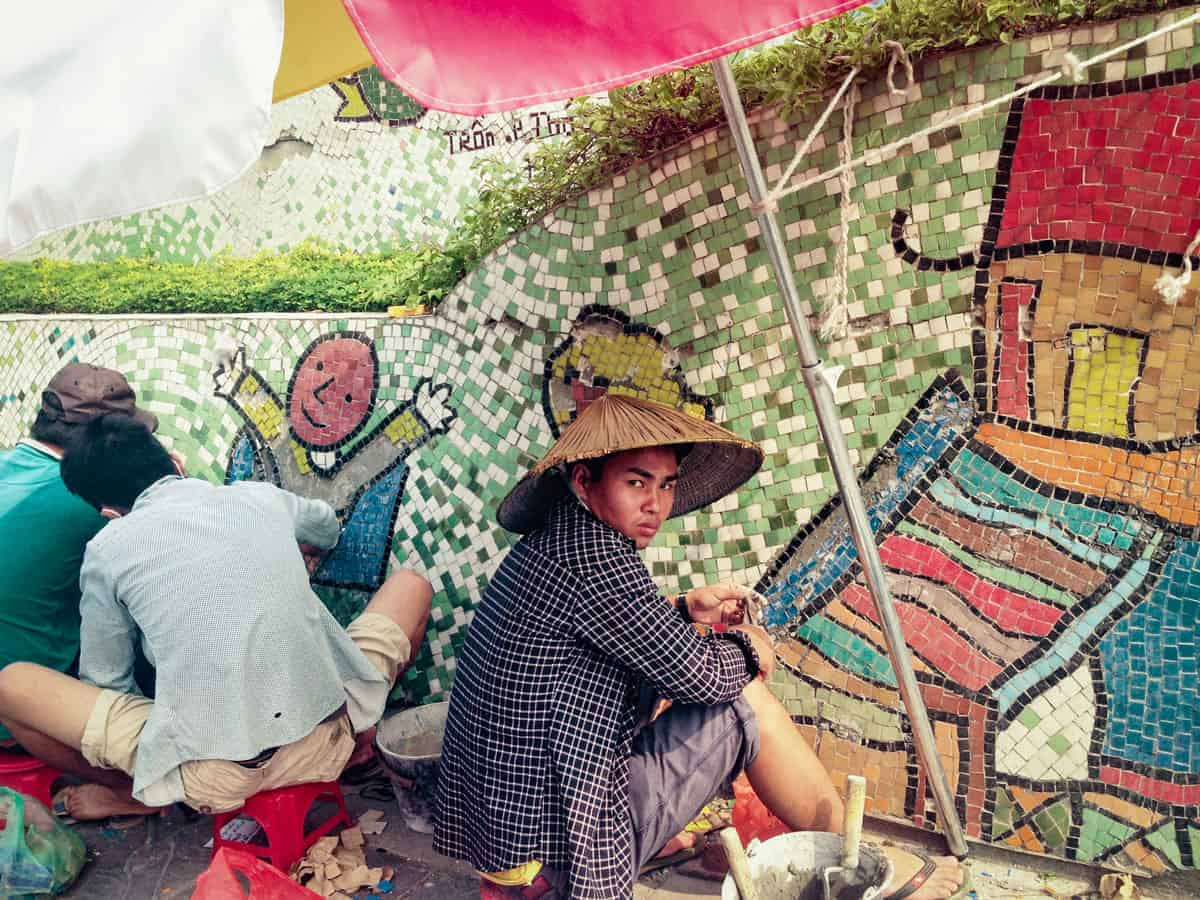 Men making murals on Ceramic Road, Vietnam.