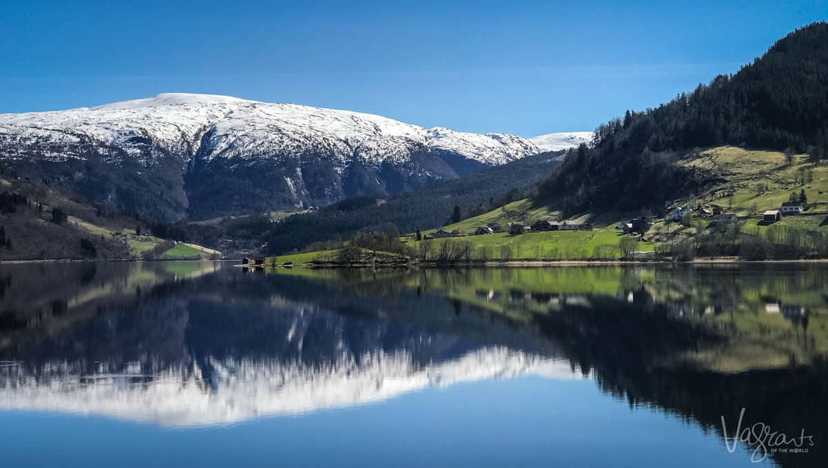 Snow capped mountain behind a fjord in Norway, spring may be the best season to visit Europe.