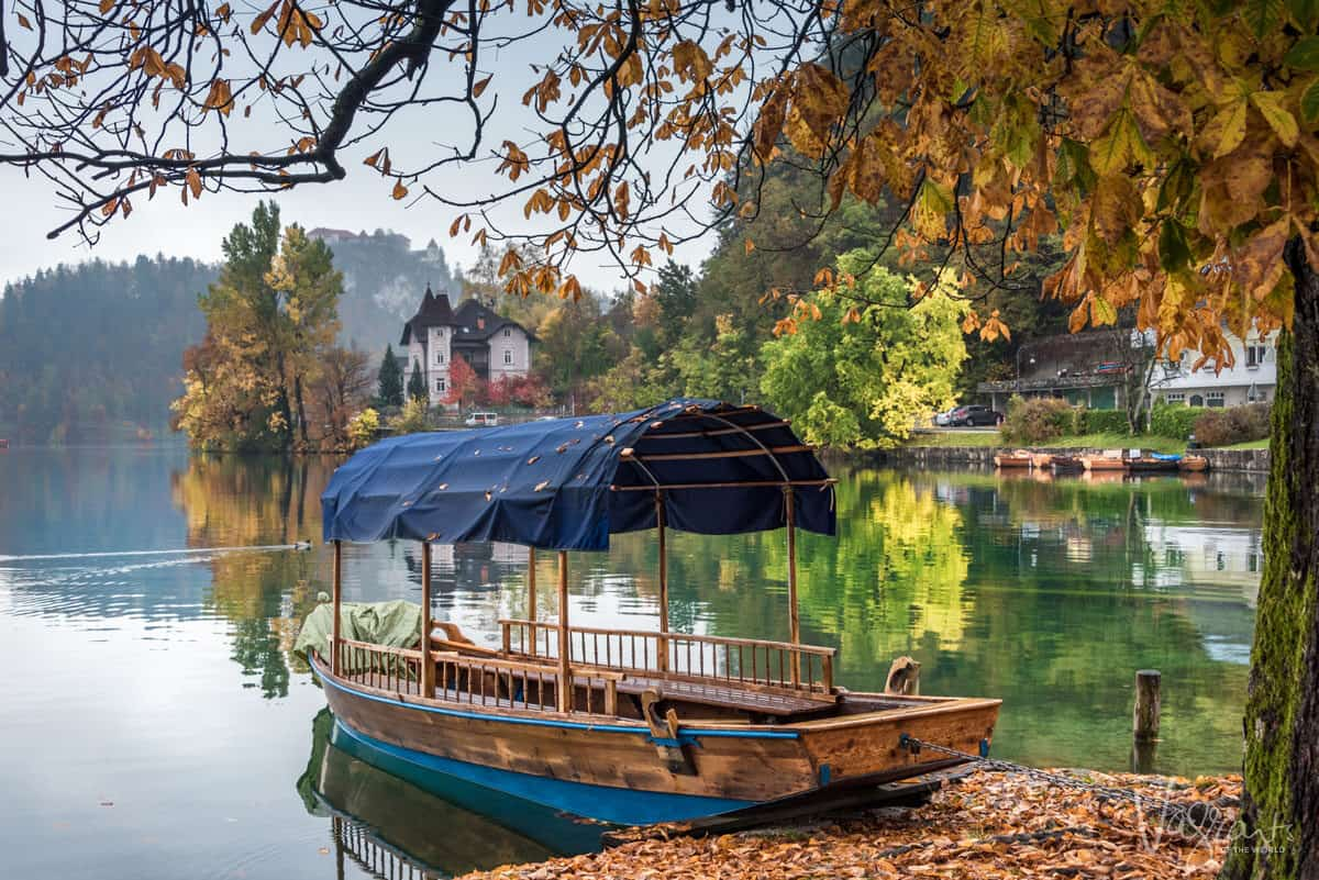 August may be the best month to visit Europe where you will see traditional boats like these silhouetted by autumn leaves.