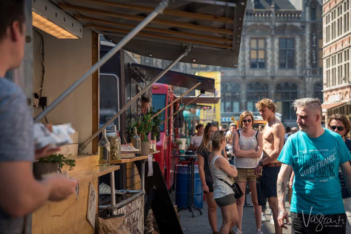 people walking past food vendors at the Ghent Food Truck Festival the best festival for foodies in Europe.