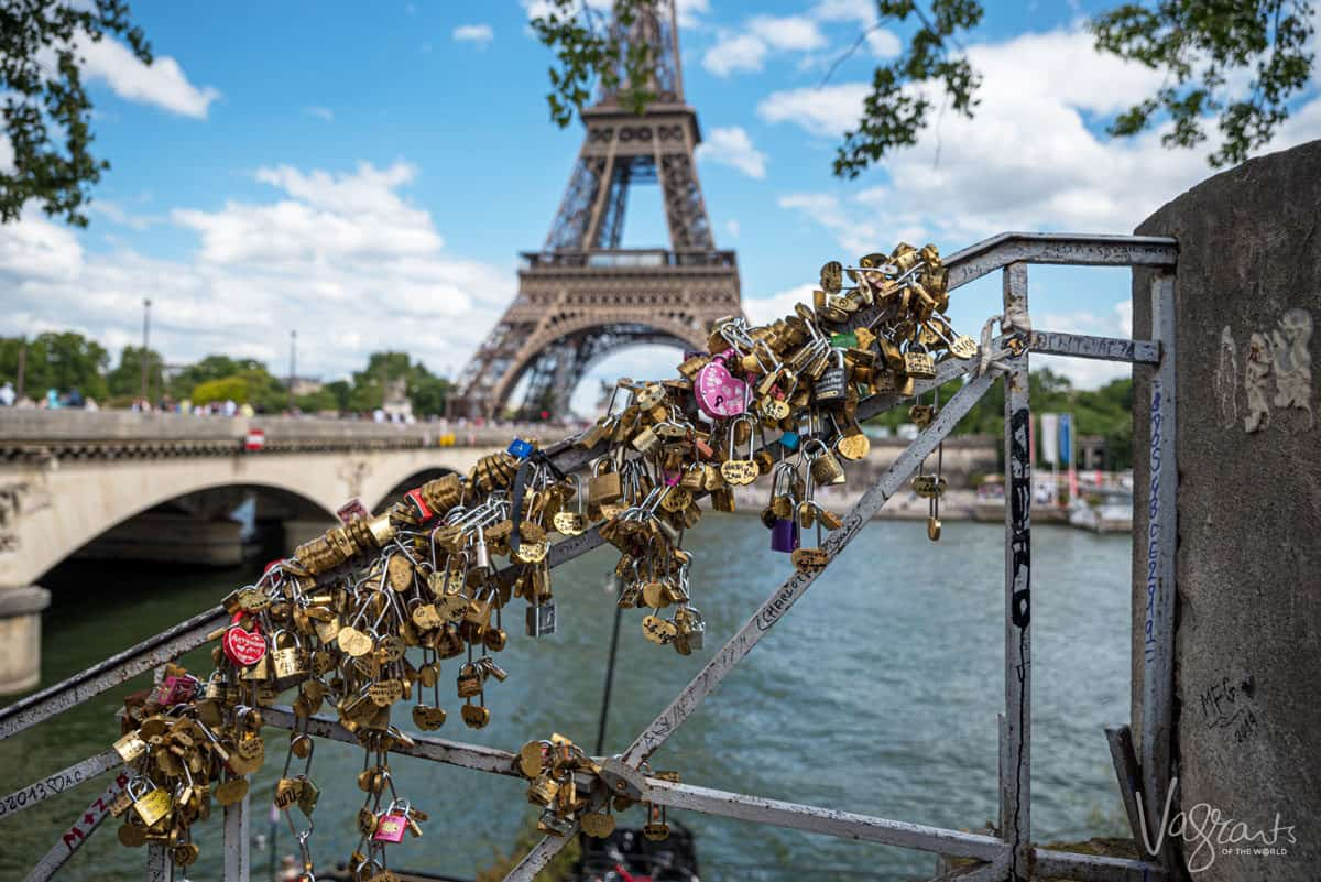 Love locks on a bridge with the Eiffel tower in the background. Read on to find out the best time to visit Europe for honeymoon.