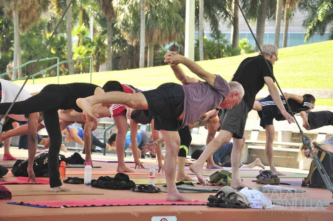 people doing Yoga in the park. There are loads of free you classes you can join throughout the week in Miami