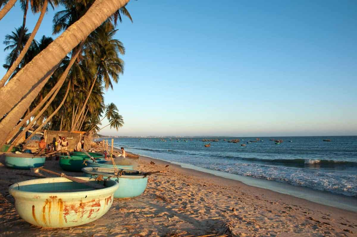 Typical round fishing boats on the beach in Mui Ne Vietnam. One of the things to see in Mui Ne