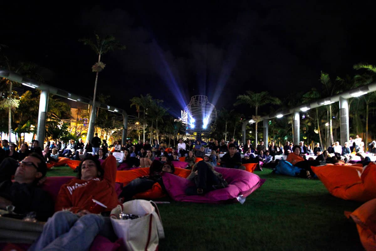 people on beanbags ate the Soundscape Series outdoor cinema in Miami. Movies and concerts are just some of the free things to do in Miami.